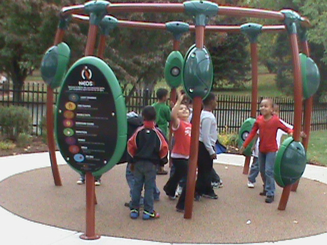 Children enjoy the new 19,900 sq. ft. playground at the official opening of the Cedar Beach Playground at Cedar Creek Park in Allentown.