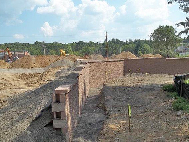 Building retaining wall and utility work